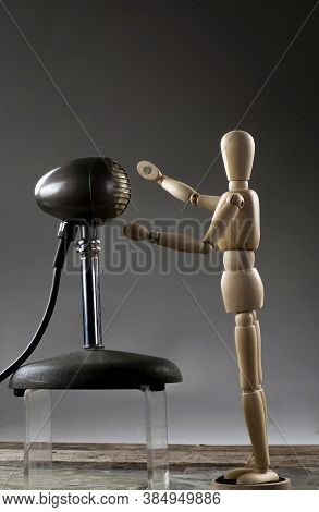 Wooden Dummy Singer Singing Into Antique Microphone With Room For Your Type.