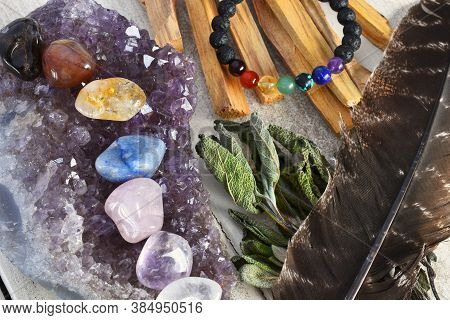 A Close Up Image Of Chakra Crystals Charging On An Amethyst Geode With Sage And Palo Santo Smudge St