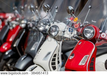 Riga, Latvia - May 4, 2019:  Row Of Classic Vespa Scooter Parked In The Central Square Of The City