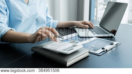 The Woman\'s Hand Uses A Calculator. Calculate The Financial Graph That Shows The Results To Summari