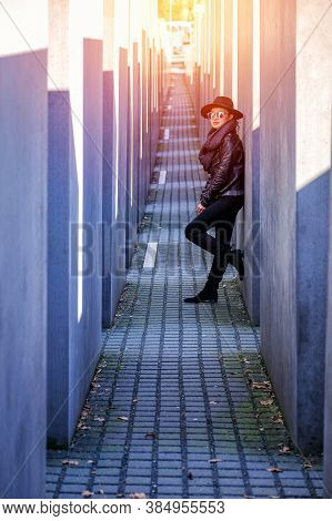 Berlin, Germany - March 26, 2017: Beautiful Young Asia Woman Tourist Walking At Holocaust Memorial T