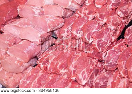 Close Up Of Meat In A Supermarket. Raw Meat At Butcher Shop