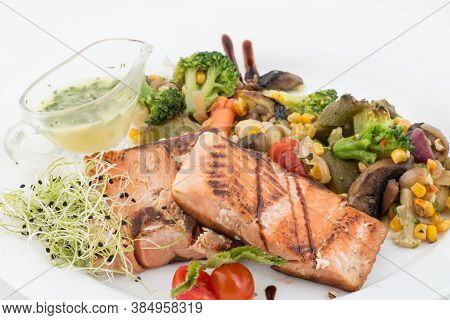 Close Up Of Grilled Salmon And Vegetables