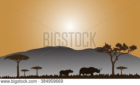 Full Frame Silhouette Family Of Rhinoceros In The Grassland On The Multicolor Background.