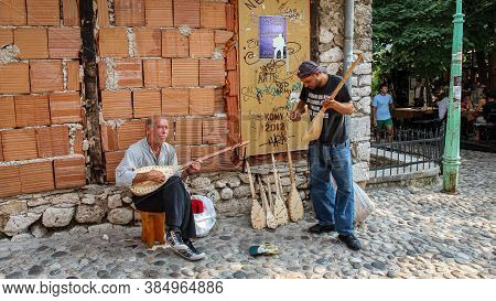 Mostar, Bosnia And Herzegovina - July 4th 2018: Two Buskers On The Street In Mostar Playing The Sarg