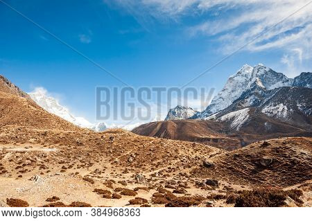 Valley Leading To The Everest Base Camp With Cholatse And Taboche Peak. Trekking In Nepal Himalayas.