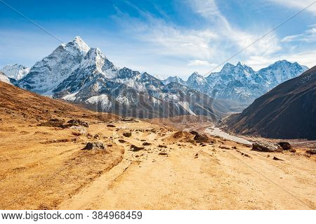 Stunning Valley With Dukh Koshi River Leading To The Everest Base Camp With Ama Dablam Peak. Trekkin