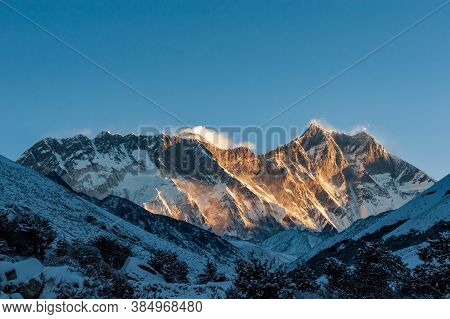 Sunrise On Nuptse, Lhotse And Mount Mt. Everest Peaks With Bird Of Prey At Front. Trekking In Nepal