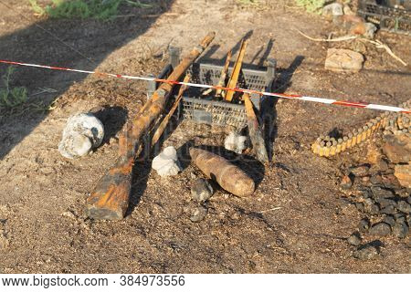 World War 2 Weapons And Ammunition Found At Sea. Old Rusty Shotgun And Ammunition, A Mine. Relics Fr