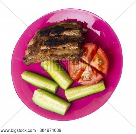 Grilled Pork Ribs With Sliced Cucumbers And Tomatoes On Pink Plate. Pork Ribs Isolated On White Back