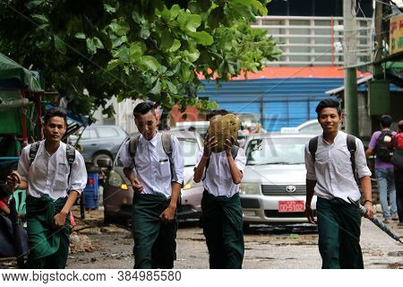 Yangon, Myanmar June 11, 2018: Four Collegians In Myanmarese Uniform Of College (white Shirt And Gre