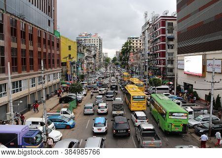 Yangon, Myanmar June 6, 2018: City View Of Anawrahta Rd. Many High Building And Lots Of Cars, In Rus