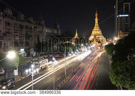 Yangon, Myanmar Feb 21, 2019: Night Time And Speed Of Light At Golden Octagon Of Sula Pagoda Located