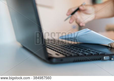 Businessman Hands Working In Laptop Computer With Paper Files Searching Information Business Report