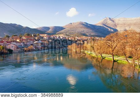 Ancient City On The Banks Of The River. View Of Trebisnjica River And  Trebinje City  On  Sunny Wint