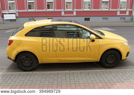 Koethen, Germany - Circa March 2016: Yellow Seat Ibiza Car Parked In A Street Of The City Centre