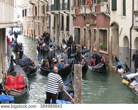 Venice, Italy - Circa March 2018: Gondola Traditional Flat Bottomed Rowing Boat In The Venetian Lago
