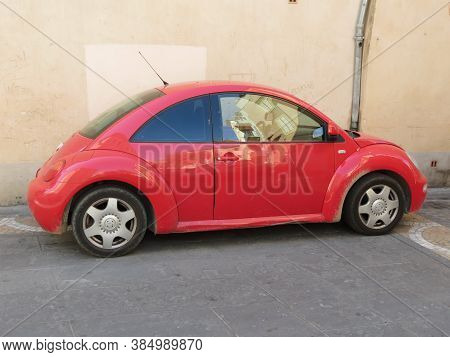Narbonne, France - Circa August 2018: Red Volkswagen New Beetle Car