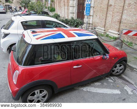 Perugia, Italy - Circa April 2019: Red Mini Cooper Car With Union Jack Flag Roof