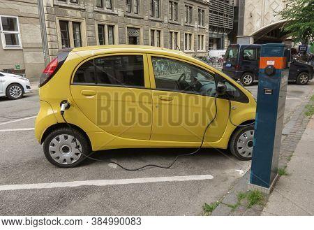 Copenhagen, Denmark - Circa June 2016: Yellow Mitsubishi Electric Car Recharging On The Street