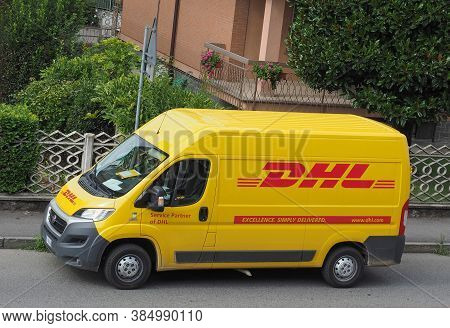 Milan, Italy - Circa August 2015: Dhl Van Parked On A Street. Dhl Is A World Wide Courier Company Th