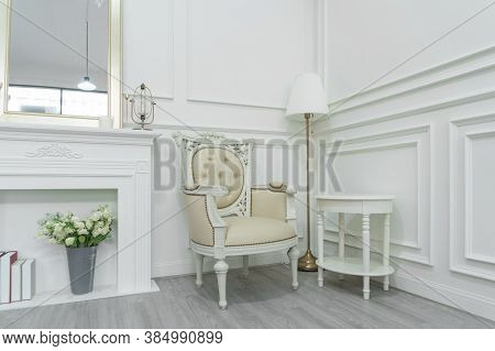 Luxury White Modern Living Room In Apartment Or Hotel With Chair, Table, Lamp, And Mirror. Interior