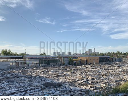 Remains Of A Destroyed Building. Wasteland With Debris Of Destroyed Premises. Construction Site For