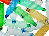 close up of empty used plastic bottles on white background with clipping path poster