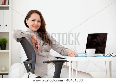 Business woman working on laptop computer at office