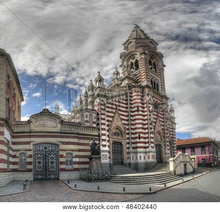 Panorama view on the Senora del Carmen church and Colegio Salesiano de Leon VIII in the historic Candelaria district of Bogota Colombia poster