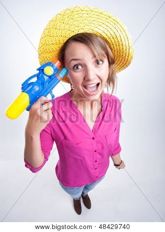 Funny Pretty Girl Wearing A Hat Holding A Water Gun Looking Cheerful