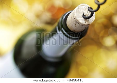 Opening a wine bottle with a corkscrew in a restaurant