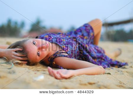 Attractive Girl Laying On Beach