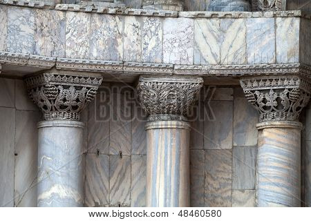 Venice - marble columns in the portal of the cathedral of St. Mark