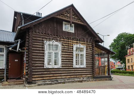 TOMASZOW LUBELSKI, POLAND - JULY 13: ancient wooden building from 1895, formerly a tearoom, now a commercial building, Tomaszow Lubelski, Poland on July 13, 2013