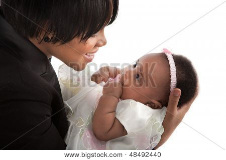 mother holding 3-month old smiling baby girl  on white background