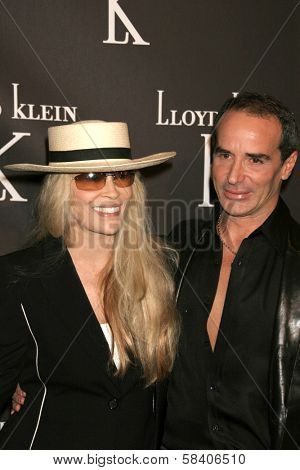 LOS ANGELES - NOVEMBER 14: Faye Dunaway and Lloyd Klein at the opening party for the Lloyd Klein Flagship Store at Lloyd Klein Flagship Store on November 14, 2006 in Los Angeles, CA.