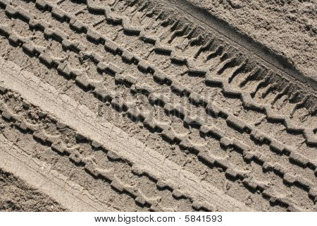 Tire Track In Beach Sand