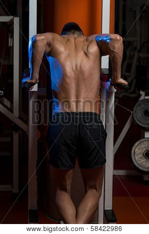 Young Male Bodybuilder Doing Heavy Weight Exercise For Triceps poster