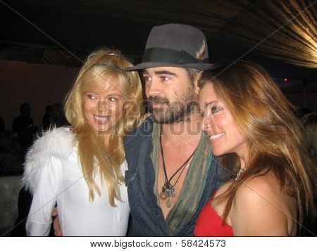 LOS ANGELES - DECEMBER 02: Shanna Olson, Colin Farrell and Alicia Arden at a party for AXE Cologne for Men on December 02, 2006 at Playboy Mansion, Los Angeles, CA.