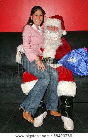 WEST HOLLYWOOD - DECEMBER 09: Cathy Shim and friend at My Stuff Bags Foundations's Holiday Stuff-A-Thon benefitting Children In Crisis December 09, 2006 in Guys, West Hollywood, CA.