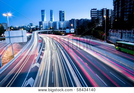 Blurred Tail Lights And Traffic Lights On Motorway