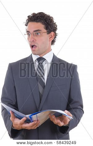 Surprised Businessman Holding An Open Notebook