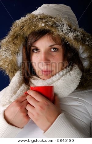 Young woman drinking a hot coffee