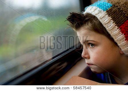 Boy Staring Through Window