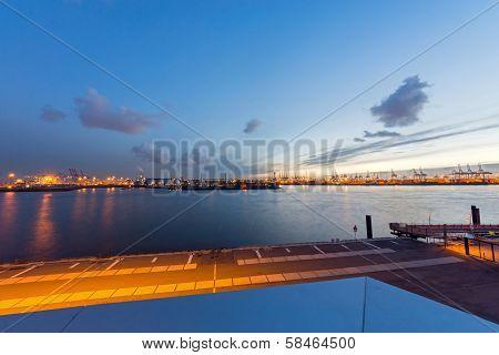 The Hamburg harbour, the biggest in Germany, at sunset poster