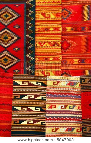 Colorful Carpets Hanging On The Market. Oaxaca, Mexico