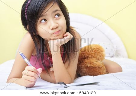 Little Girl Writing Her Diary