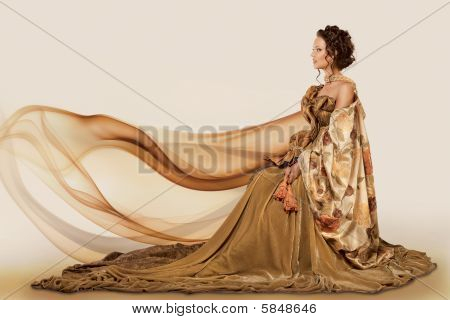 Woman sitting in a gown