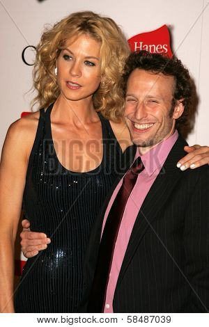 HOLLYWOOD - AUGUST 27: Jenna Elfman and Bodhi Elfman at the TV Guide Emmy After Party August 27, 2006 in Social, Hollywood, CA.